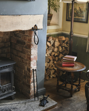 Keep cosy by the fire with our fireside accessories
